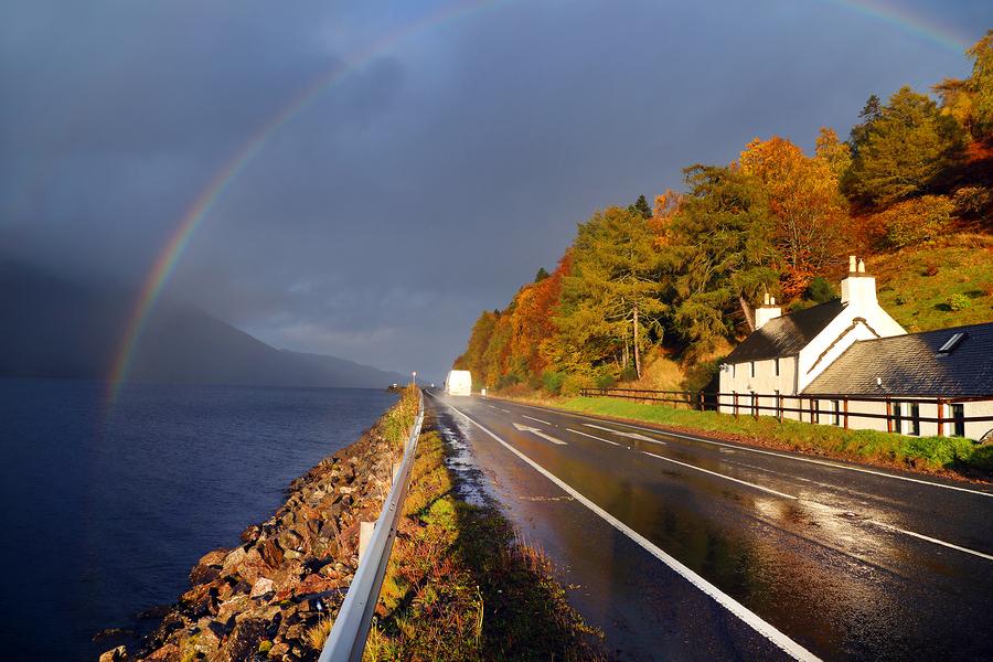 Road in autumn landscape, Highlands, Scotland, United Kingdom